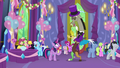 Discord returns to normal size in a purple suit S7E1.png