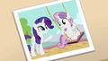 Photo of Rarity pushing Sweetie Belle on swing set S7E6.png