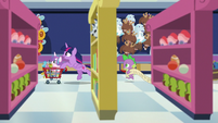 Twilight and Spike race through the toy store S7E3
