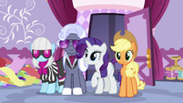 Rarity and her fellow judges enter the sewing room S7E9