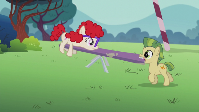 Yellow colt lifting see-saw with his teeth, screenshot from S5 E8