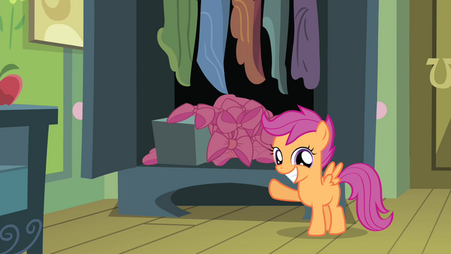 File:Scootaloo pointing at Apple Bloom's many bows S4E17.png