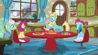 Fluttershy gives her parents a look of disbelief as Zephyr hugs her S6E11