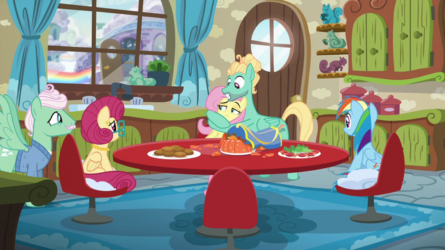 File:Fluttershy gives her parents a look of disbelief as Zephyr hugs her S6E11.png