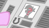 Question mark on a pony on a newspaper S2E23
