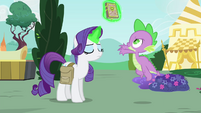 Rarity levitates the book away from Spike S4E23