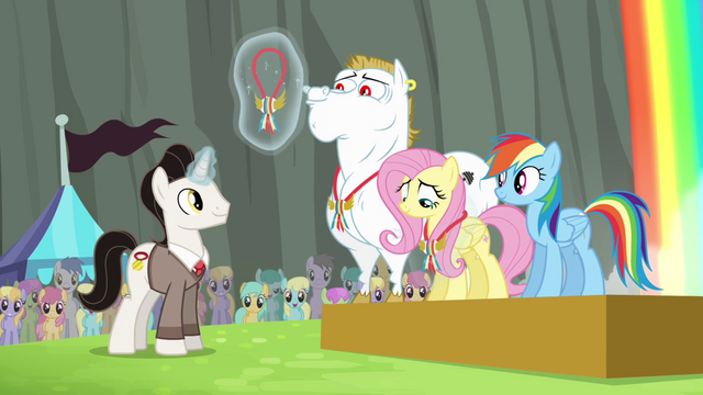 File:Timekeeper giving medals to Ponyville team S4E10.png