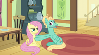 Zephyr sets Fluttershy down on the floor S6E11