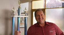 Jay poses with Mannys' award