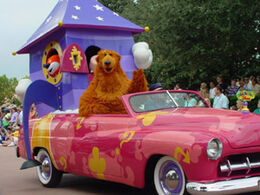 Stars and motorcars parade bear