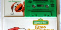 Elmo Saves Christmas (book and tape)