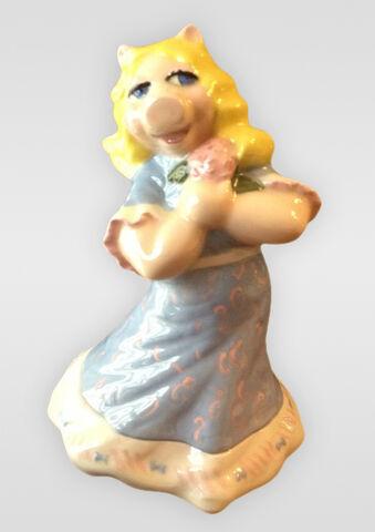 File:Porcelain-Piggy-holding-flower.jpg