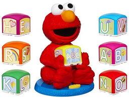 Elmo find and learn alphabet blocks