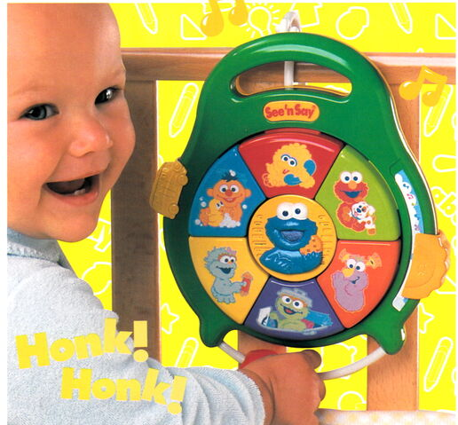 File:Fisher-price 2001 catalog see 'n say bring-along cookie monster baby.jpg