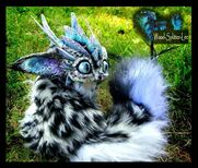 Sold posable snow leopard dragon by wood splitter lee-d3il08y