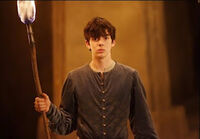Edmund with torch
