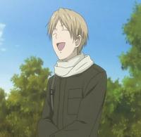 Natsume laughing at the fallen nyanko