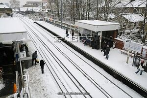 Passengers wait on a snowy railway station 4602791