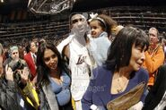 Kobe Bryant celebrates with his wife Vanessa and daughter Natalia after he scored 81 points