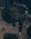 Giant lifting a boulder