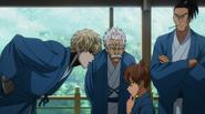 Genos defending Saitama