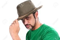 13961433-A-cool-Indian-guy-wearing-a-hat-on-white-studio-background--Stock-Photo