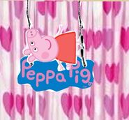 Peppa Lyes Down on The Peppa Pig Logo
