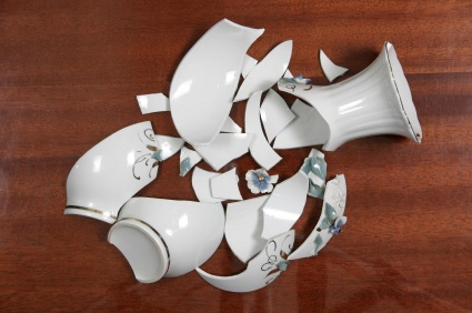 File:Smashes the vase.jpg
