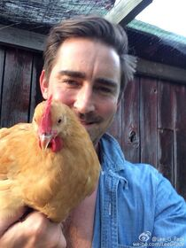 Lee Pace with a chicken