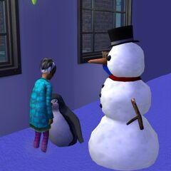 Mała Simka głaszcząca pingwina