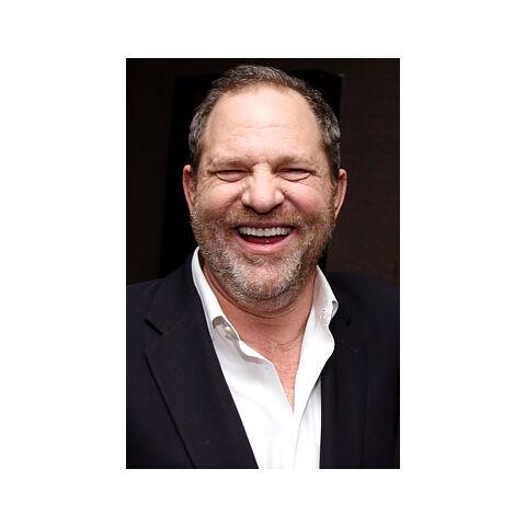 Harvey smiles.