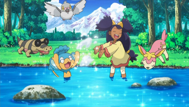 File:Little Iris plays with Pokemon.png