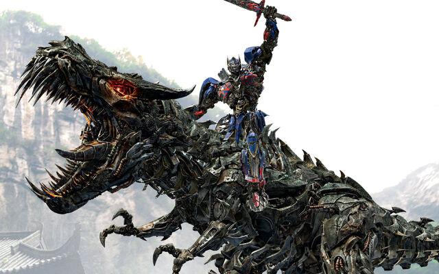 File:Optimus prime riding grimlock-wide.jpg