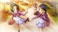 Komachi and Karen running from Nozomi