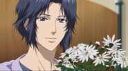 Yukimura looking at flowers