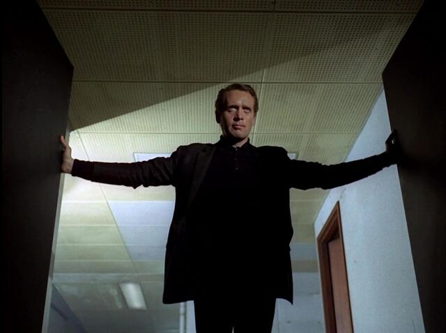 File:Number Six storms into his superior's office.jpg