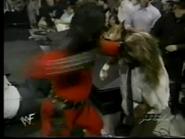 Fake Kane punches Mankind