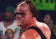 Kane unmask 6-23-03