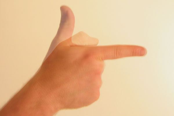 File:Gesture thumb up then down forefinger out like gun.jpg