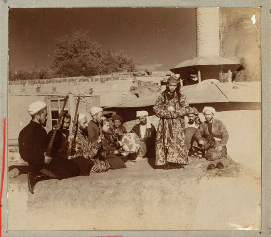 File:Samarkand A group of musicians playing for a bacha dancing boy.jpg