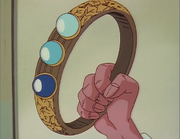 Happosai holds Pill Bracelet