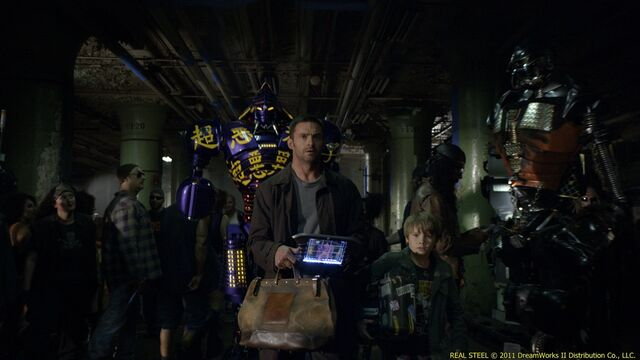 File:Down-on-his-luck fight promoter charlie (hugh jackman) and his son, max (dakota goyo) enter their star robot boxer noisy boy in a match.jpg