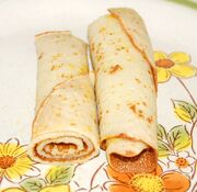 Roly-Poly Pancake with filling, cut in half to illustrate rolling
