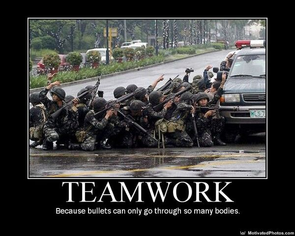 File:633516808315836003-teamwork---because-bullets-can-only-go-through-so-many-bodies---demotivator.jpg
