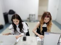 Wendy and Irene on laptops