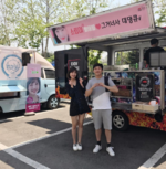 Joy in front of a food truck