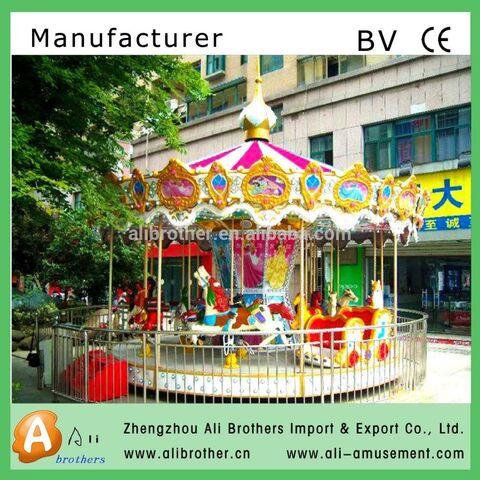 File:Amusement park merry go round kiddie little.jpg