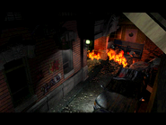 Resident Evil 3 Nemesis screenshot - Uptown - Street along apartment building - Jill Valentine scene 02