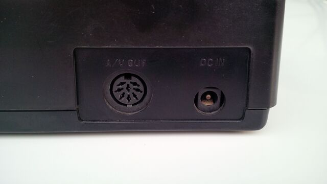 File:Neo Geo AES power and multi-out AV port.jpg