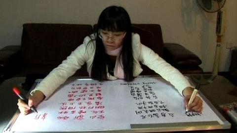 AMAZING Woman Writes With Two Hands Simultaneously